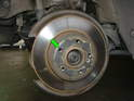 You'll need to take the tension off the inner brake shoe in order to remove the rear brake disc.