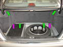 The upper shock mounting points are accessed by opening the rear trunk.