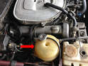 The coolant expansion tank is located to the right side of the car.