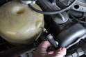 Remove the hose from the expansion tank.
