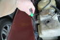 Loosen and remove the 8mm bolt from tank.