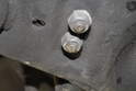 There will be two 13mm nuts that hold the shock absorber to the lower control arm.