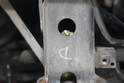 The two 13mm bolts that hold the sway bar in place are located behind the bumper.
