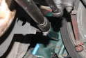 The steering dampener strut is held on using a crown bolt and cotter pin arrangement.