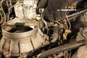 With a 10mm socket wrench, remove the clamp holding the fuel line which is connected to the Cold-start Valve.