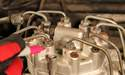 Use a marker to number the fuel injector lines located on top of the distributor.