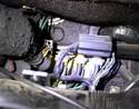 Once the glove box is out, you will see the vacuum switchover valves located to the right side of the car.