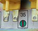The bi-level climate control vacuum switch has a color code next to it and a number.