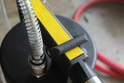 Using a 9mm open end wrench, turn the bleed screw clockwise to open the flow of brake fluid.