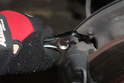 Using a 15mm socket wrench loosen but don't remove the 4 bolts that hold the calipers together.