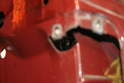 There is a Phillips head screw located inside the door panel that holds the handle in place.