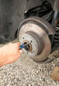 The parking brake's shoes contact the rotors' â€Ã...
