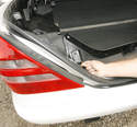 With the rear panel unfastened, the trunk light can be unplugged.