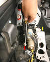 Using a trunk cylinder for demonstration purposes, removal begins by opening the trunk with the Vario roof switch, then turning off the ignition to depressurize the hydraulic system.