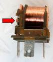 Inside the relay, the coil converts the incoming low-current voltage to higher current.