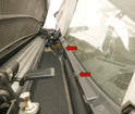 With the roof lowered part way, the insulation strips (arrows) can be slid onto the roof panel's lip (red arrows).