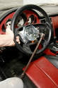 The steering wheel must be stabilized so that the force required to loosen its retaining screw (which takes a 10mm hex/Allen bit) doesn't damage the steering wheel's locking mechanism.