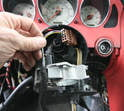 To remove the cruise-control switch assembly, feed the wiring harness and plug out through the steering column.