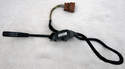 The replacement cruise control stalk/switch includes the harness and plug--the wires are soldered to the switch.