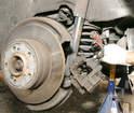 If retaining the brake hose, pinch it shut to discourage leakage.