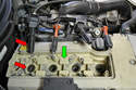 With everything freed up set the entire harness on the top of the engine so you don't mix the connector to plug up when it comes to reinstallation (red arrows).