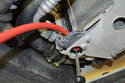 If you attach a clean drain hose to the spigot it will make safely capturing the coolant easier.