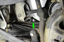 Move to under the engine and loosen the drain plug on the right side of the engine block (green arrow) with a 19mm wrench or socket.