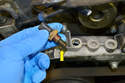 You can use the probe end of the sensor (yellow arrow) to get an idea of the shape of your cooling system and coolant.