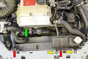 From the top of the engine you will need to remove the two clips that hold the shroud to the radiator (red arrows), the hose clip on the right side of the shroud (green arrow) and the two 10mm bolts that hold the overflow reservoir tank (yellow arrows).