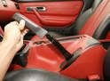 Some owners claim that the console can be finessed over the parking-brake lever with the rubber handle still in place.