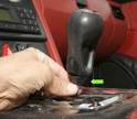 On cars with manual transmissions, the boot needs to be unclipped (two clips on either side of the console).