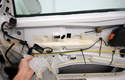 Peel the plastic weather shield liner toward the front of the car to uncover the access hole at the bottom of the door.