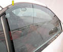 Adjust the window stops until the glass's upper edge seals on the weather stripping (yellow arrow).