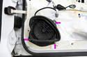 To remove the speaker, undo three Phillips screws (purple arrows).