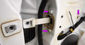 The limiter mounts to the door with three bolts (purple arrows), all of which take a 10mm wrench/socket.