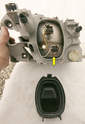 Burned-out head light bulbs can normally be replaced on-vehicle by pulling off the black cover to reveal the plugs.