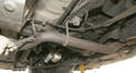 The OEM exhaust system has a grounding flange in front of the rear axle.