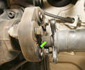 After the driveshaft is de-coupled from the flex disc, it needs to be collapsed away from the pinion yoke's centering pin (green arrow).