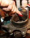 Liberally apply high-quality bearing grease to the knuckle's bore.