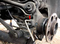 In the rear, use a 5mm hex/Allen wrench or bit to remove the sensor's retaining screw (arrow).