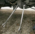 To remove the lower control arm/spring link/dog bone, the arm must be unbolted from the knuckle.