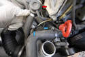 Remove the two small hoses (blue arrows) between the supercharger and the secondary air injection valve (red arrow).