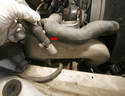 The valve's main hose also needs to be removed from the supercharger (arrow).