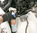 Clean any spills, dirt, and debris off the fender and area around the power steering pump and hoses.