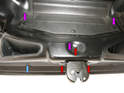 Three bolts having T27 Torx heads (red arrows) connect the latch to the body.