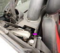 The Open/Lowered Limit Switch (arrow) is located under the plastic B-pillar trim piece on the right side.