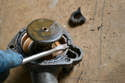 If your thermostat has not been changed in a long time the rubber gasket can become brittle and difficult to remove.