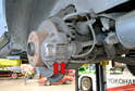 The rear brakes on the W123 are a dual piston caliper and both pads (red arrows) can be replaced without removing the caliper.