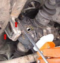 Use a 13mm socket and remove the two bolts holding the bushing to the frame (red arrows) and remove the bushing.