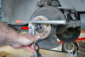 Some people like to break loose the axle shaft bolt using the parking brake as a way to the axle in place but it can put a tremendous stress on the parking brake.